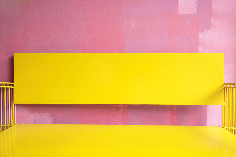 Vintage bright yellow Bench Against grunge pink painted Wall, bright summer colour Minimal Pink Wall Yellow Bench Art And Craft Backgrounds Blank Close-up Copy Space Creativity Education Empty Grunge Indoors  Multi Colored No People Office Paint Painted Image Paper Pink Color Purple Striped Studio Shot Textured  Wall - Building Feature Yellow Brush Stroke
