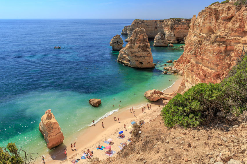 One of the worlds most beautiful beach, the Praia da Marihna at the Portuguese Algarve Coast Sea Water Scenics - Nature Land Rock Beauty In Nature Beach Rock - Object Tranquil Scene High Angle View Rock Formation Horizon Over Water Nature Solid Day Tranquility Horizon Sky Idyllic Outdoors Turquoise Colored Caramujeira Praia Da Marinha Algarve Portugal