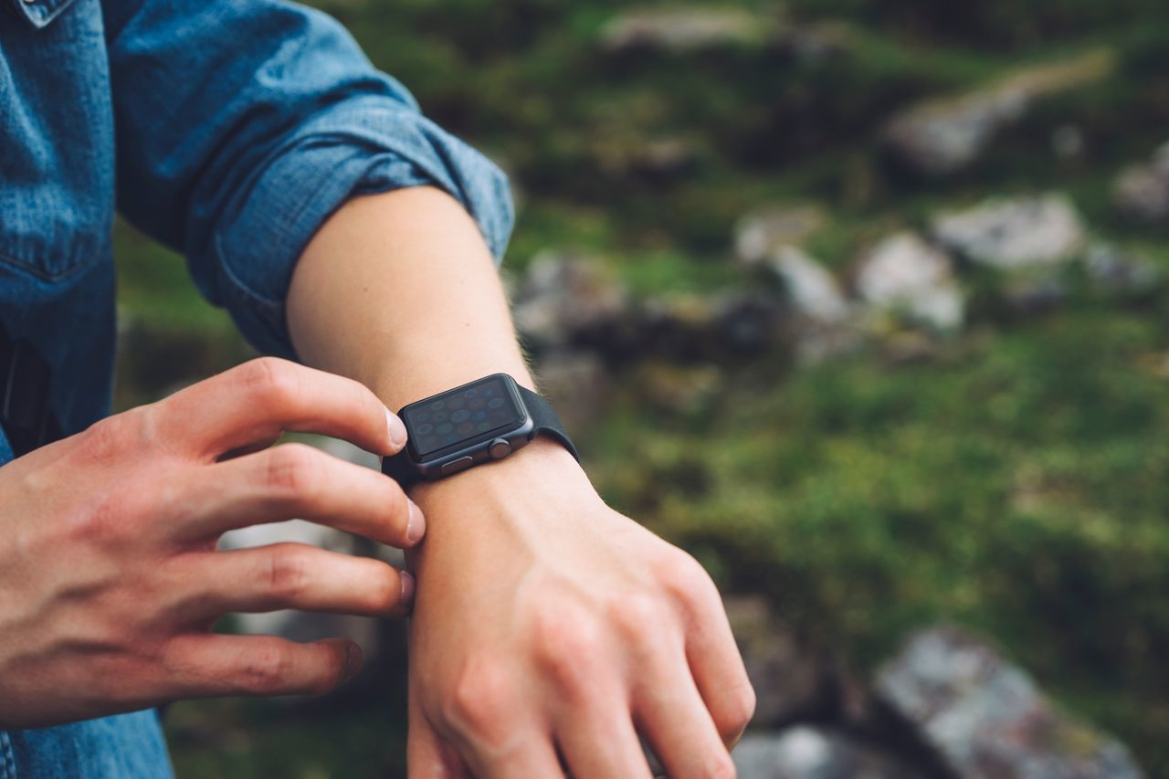 Human hand with wristwatch