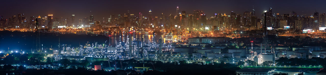 Panorama view of oil refinery and city center skyline, bangkok, thailand