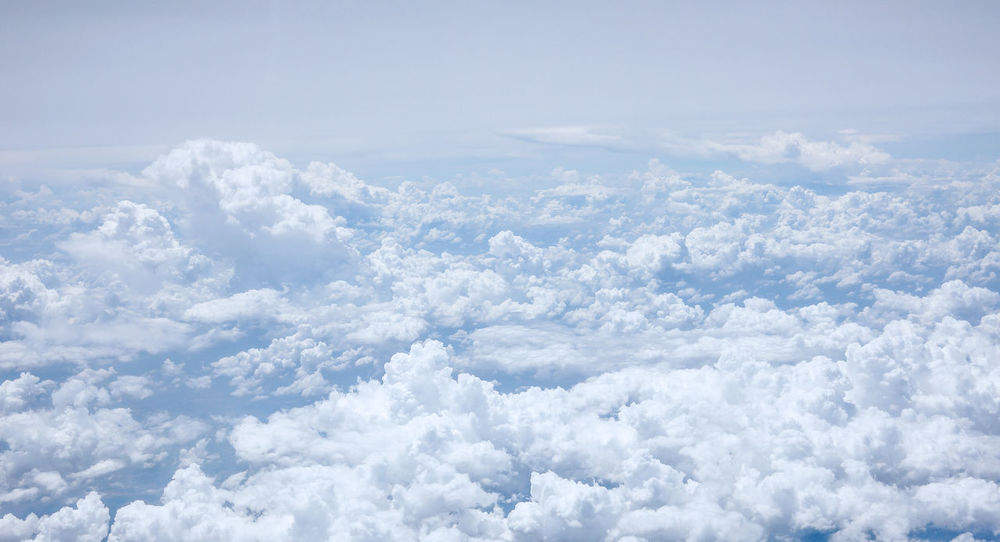 Top view from plane Atmosphere Above Abstract Backgrounds Beauty In Nature Blue Cloud - Sky Cloudscape Day Dramatic Sky Fluffy Heaven Nature No People Outdoors Scenics Sky Sky Only Softness Tranquility Wallpaper Weather White Color Wind