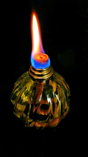 Flame Close-up Burning Illuminated Glowing Black Background Lamp Oil Lamp Fire Light And Shadow Glowing ☺ Light Source Darkroom No People Yellow Glow Heat - Temperature Fire - Natural Phenomenon Night Time