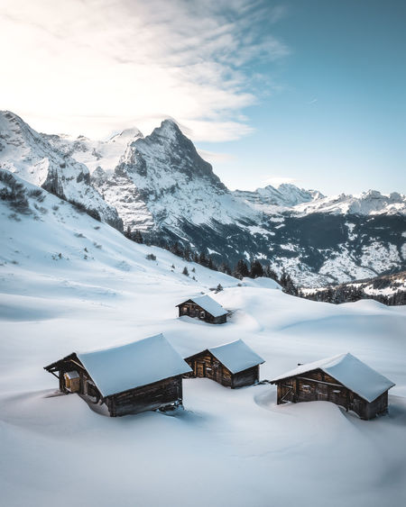 Snow Winter Cold Temperature Mountain Scenics - Nature Sky Beauty In Nature Mountain Range Snowcapped Mountain Environment Architecture Building Built Structure Building Exterior No People House Nature White Color Tranquility Outdoors