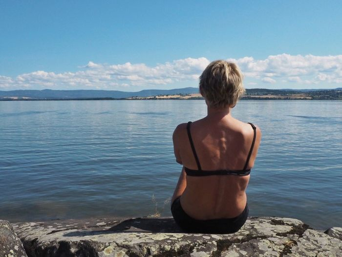Peace Holiday Summer Recreation  Water Rear View Sky Scenics - Nature One Person Leisure Activity Beauty In Nature Lifestyles Nature Real People Cloud - Sky Sea Shirtless Tranquil Scene Sunlight Three Quarter Length Tranquility Beach Day Looking At View