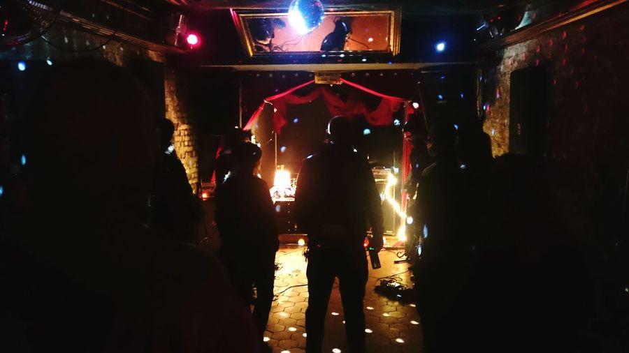 Blurred motion of illuminated people at night