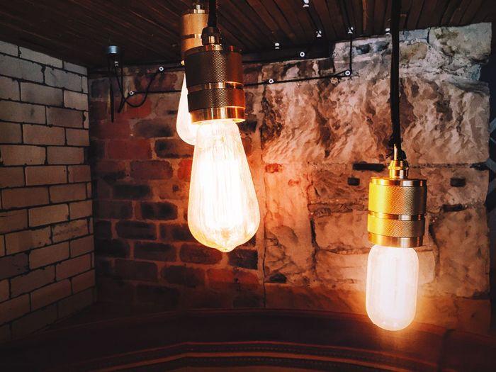 Electric lamp in illuminated room