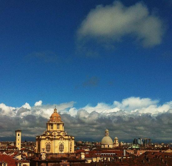 Buildings against cloudy sky