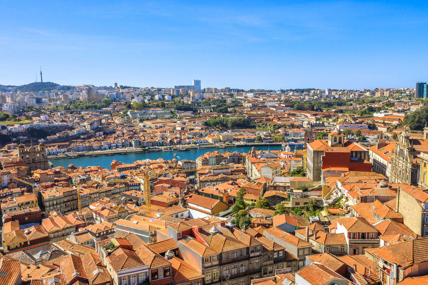 Oporto urban landscape on Douro River and city skyline from Clerigos Tower, the highest point in the city of Porto. Cathedral or Se do Porto and Episcopal Palace or Paco Episcopal on background. Portugal Porto Tourism City Aerial View Cloudscape Cityscape Landscape Panorama Europe People Church Church Architecture Architecture Town Porto Portugal 🇵🇹 Monment Oporto City Oporto Downtown Oporto Streets Building Exterior Built Structure Residential District Building Roof High Angle View Crowded Sky Crowd House Nature Day Community TOWNSCAPE Clear Sky Outdoors Settlement