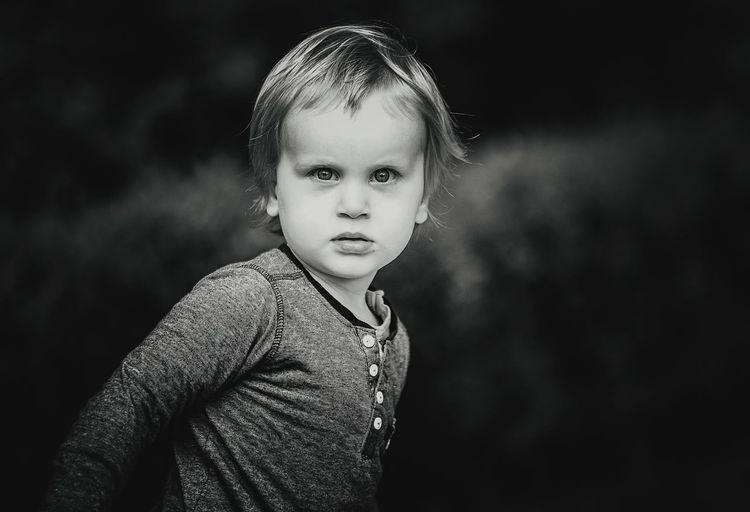 Portrait of cute boy against sky