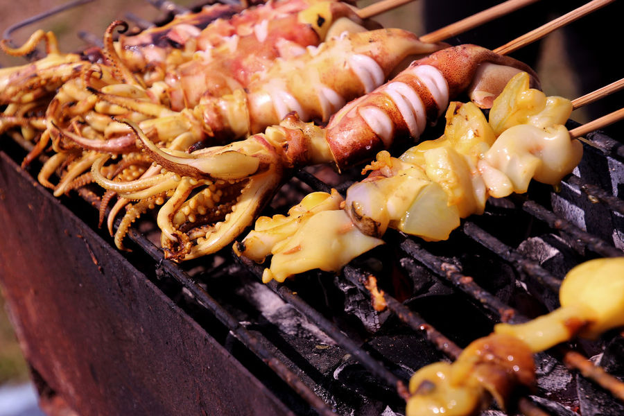 Close-up of Thai Grilled Squid on Broiler Cooking Hot Barbecue Barbecue Grill Broiler Close Up Close-up Food Food And Drink Grilled Healthy Eating Meat Preparation  Ready-to-eat Seafood Skewer Squid Street Food Street Photography