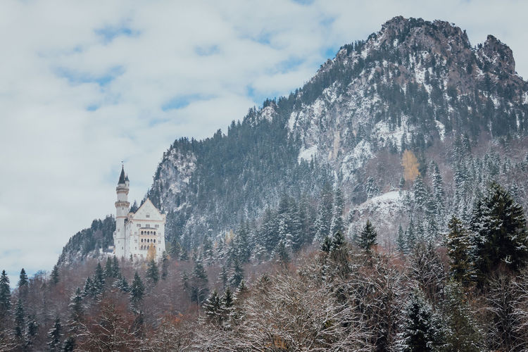 Hohenschwangau, Germany - November 17, 2017: Beautiful view of famous Neuschwanstein Castle with scenic mountain landscape near Fussen, southwest Bavaria, Germany. Architecture Built Structure Building Exterior Mountain Sky Building Nature Place Of Worship Cloud - Sky Tower Day Cold Temperature No People Outdoors Neuschwanstein Castle EyeEm Best Shots EyeEm Best Edits Bavaria Alps Forest King - Royal Person Germany Cultures Disney My Best Photo