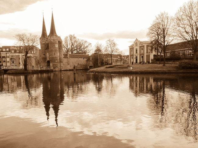 Architecture Bare Tree Bridge Building Building Exterior Built Structure Canal Castle Day History No People Outdoors Reflection Sepia Sepiatone Sky Travel Travel Destinations Tree Water Waterfront