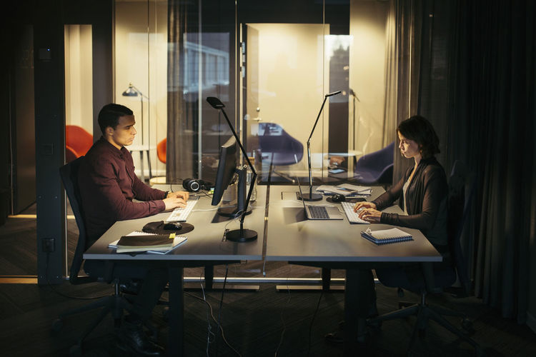 People working on table at home