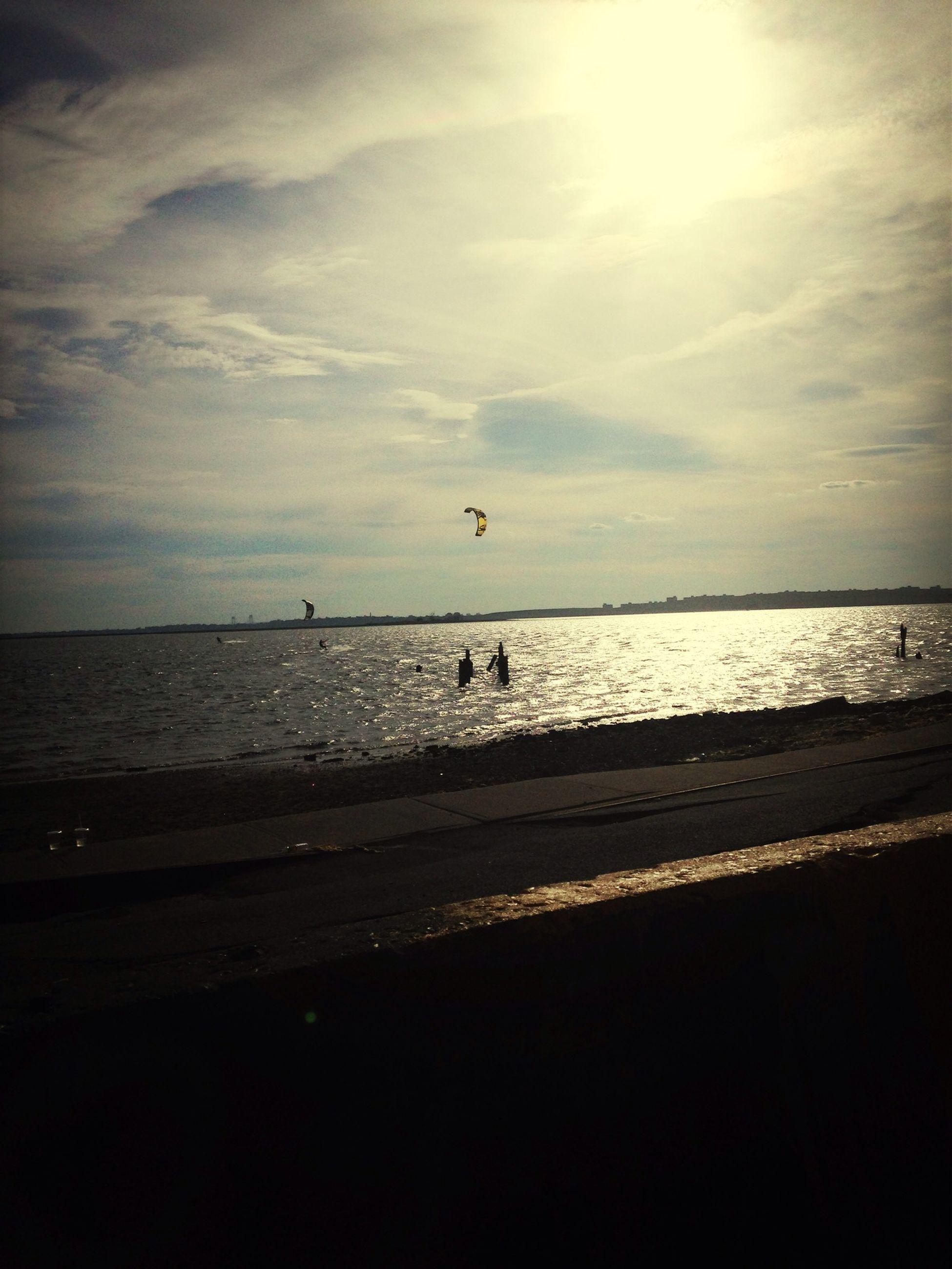 sea, horizon over water, beach, water, sky, scenics, shore, tranquil scene, tranquility, beauty in nature, cloud - sky, sun, nature, sand, silhouette, sunlight, idyllic, animal themes, sunset, cloud