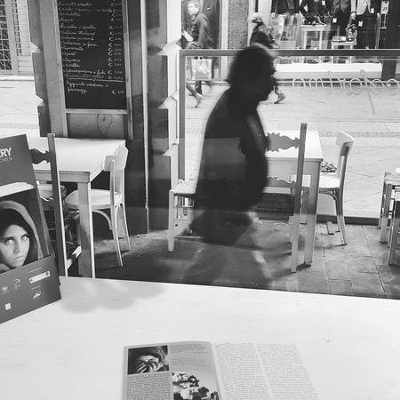 -PEOPLE- Forlì today Peoplephotography Exhibition Black And White Photography Black And White Random People Capture The Moment Photo Exhibition Street Photography Street Portrait Streetphotographer Streetphoto from inside a Restaurant