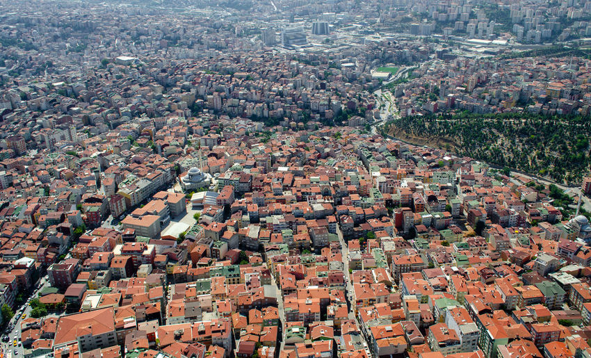 Red roofs of Istanbul low-rise buildings. View from above. Roofs and quarters of Istanbul Architecture Building Exterior Built Structure Residential District City Building High Angle View Crowd Cityscape Crowded Day Aerial View Nature Full Frame Roof Outdoors House Community TOWNSCAPE Urban Sprawl архитектура Стамбул здания ВИД СВЕРХУ высота  выставка застройка квартал крыши урбан городской пейзаж дом