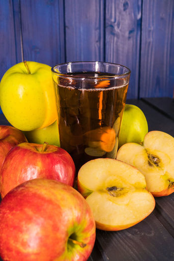 Food And Drink Food Fruit Healthy Eating Wellbeing Freshness Apple - Fruit Yellow Table Wood - Material Close-up Citrus Fruit Indoors  Still Life No People Red Apple Lemon Orange Household Equipment Glass Ripe