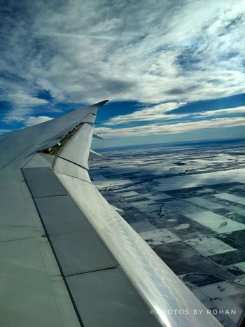 A Bird's Eye View Aerial View Aircraft Wing Airplane Airplane Wing Cloud - Sky Dreamliner Flying Horizon Journey Landing Looking Down Mid-air Plane Scenics Snowy Landscape Wintertime