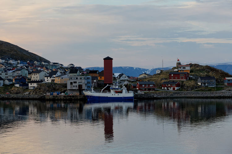 Landscape of Norway, Honningsvag. Honningsvag Honningsvag Norway Norway Travel Travel Photography Architecture Building Building Exterior Built Structure City Cloud - Sky House Mode Of Transportation Nature Nautical Vessel No People Outdoors Passenger Craft Reflection Residential District River Sky Town TOWNSCAPE Transportation Water Waterfront