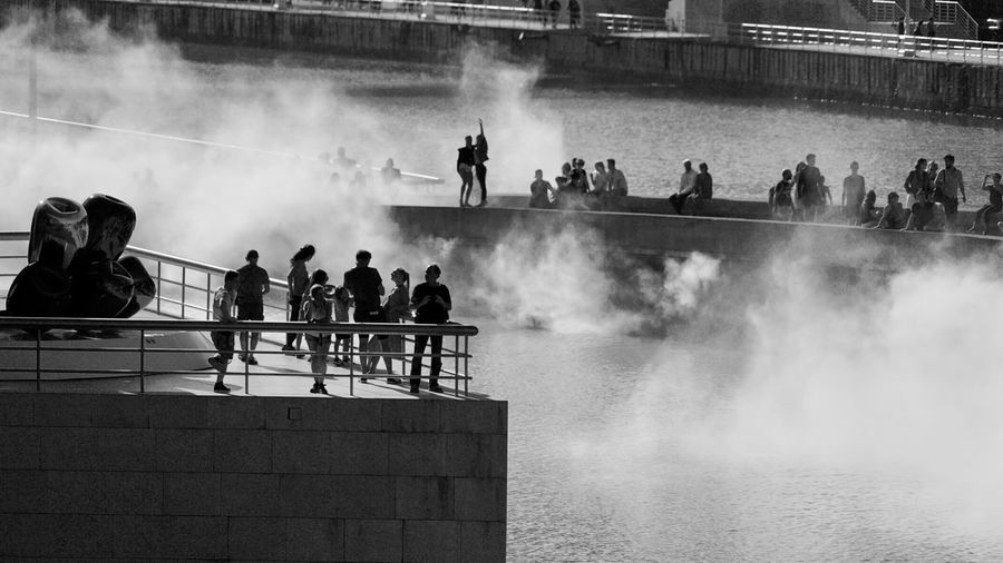 People Smoke Museum Of Modern Art Group Of People Real People Crowd Water Large Group Of People Architecture Men Smoke - Physical Structure Outdoors Spraying Building Exterior Day Leisure Activity