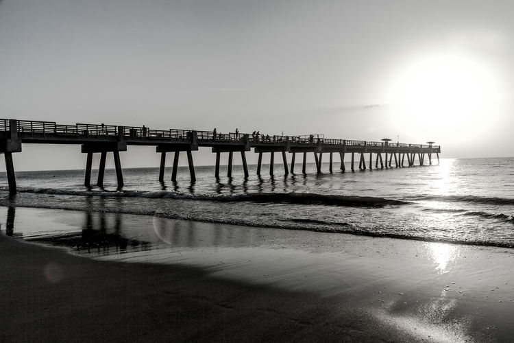 Sunrise at Jacksonville Beach, Florida. Travelling Travel Photography Travel Destinations Travel Black And White Day Built Structure Sky Sea Water Sun Horizon Beauty In Nature Tranquil Scene Tranquility Scenics - Nature Nature Beach Pier Jacksonville Florida