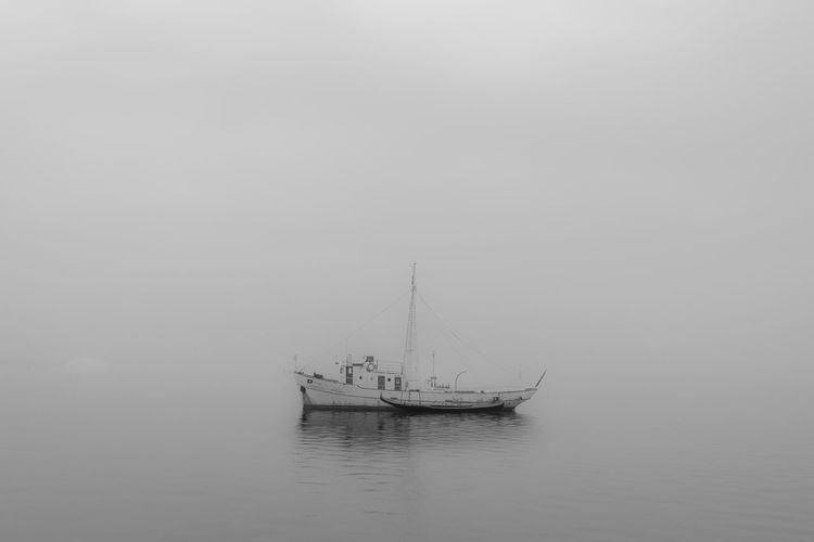 Sailboat Sailing In Sea Against Sky During Foggy Weather