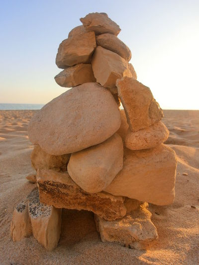 Stones Stone - Object Arid Climate Balance Beach Beauty In Nature Clear Sky Day Desert Nature No People Outdoors Rock - Object Salt - Mineral Salt Flat Sand Scenics Sea Sky Stack Tranquil Scene Tranquility Travel Destinations Water