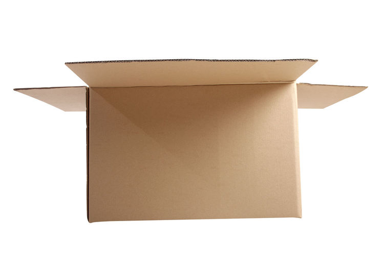 Close-up of cardboard box over white background
