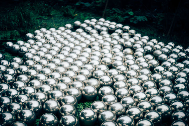 Close-up In A Row London Modern Art Mysterious Objects Pond Silver Balls White White Color