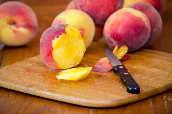 closeup of sliced peaches on a cutting board Agriculture Fresh Produce Hello World Knife Nature Orange Summertime USA Vitamins Food Fresh Fruit Healthy Eating Juicy Just Picked Michigan Peaches Natura' Organic Peach Peaches Produce Sliced Fruit Sweet Tasty Yellow