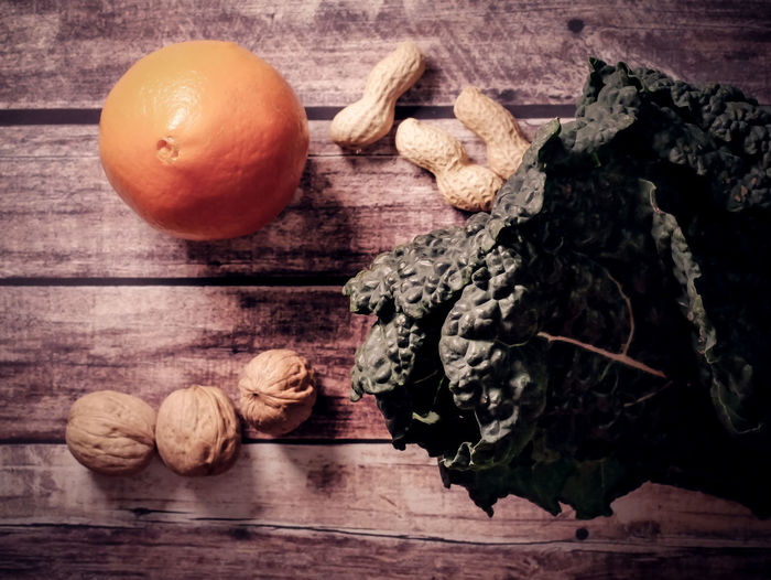 Food And Drink Food Table Freshness Wood - Material Wellbeing Healthy Eating Still Life Indoors  No People Walnut Fruit Spice Nut Vegetable Close-up Ingredient Nut - Food High Angle View Raw Food Snack Black Cabbage