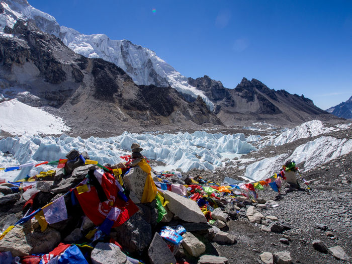 Prayer flags and visitor memorials at Everest Base Camp, overlooking Khumbu Glacier Himalayas Adventure Cold Temperature Mountain Mountain Range No People Scenics - Nature Snowcapped Mountain