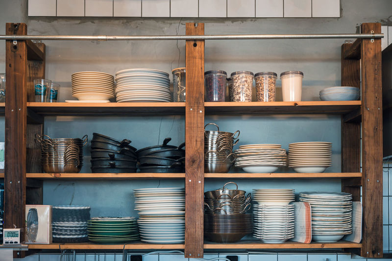 Stack of crockery in shelf at store