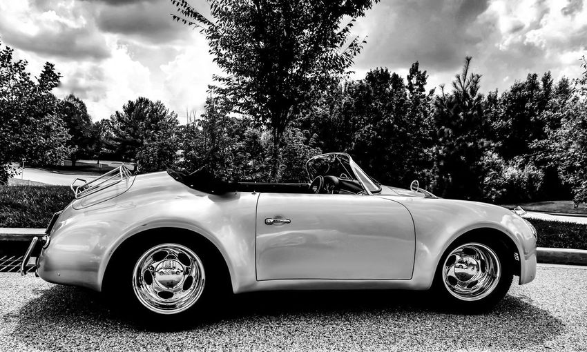 Tree Car Land Vehicle Transportation Retro Styled Luxury Vintage Car Old-fashioned Sky Cloud - Sky Mode Of Transport Vintage Outdoors Day Collector's Car Growth No People Trophy Car Classic Car Vintage Cars Sportscar JGLowe
