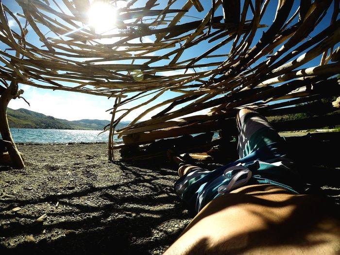 Low Section Human Leg Beach Shoe One Man Only Human Body Part Sea Nature Beach Life Cabin Shelter Relaxing Napping Fort Beach Huts Inside Of Wide Angle Gopro Lines Light Light And Shadow Lake Lakelife Sunny Sunshine The Great Outdoors - 2017 EyeEm Awards Done That. Perspectives On People See The Light An Eye For Travel Love Yourself Summer Exploratorium Capture Tomorrow