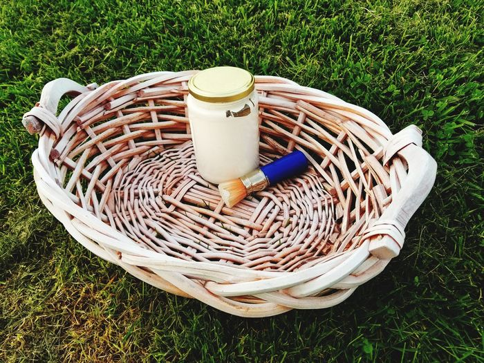 High angle view of wicker basket on field