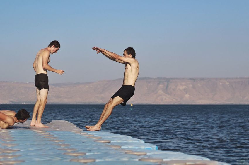Enjoy The New Normal Kineret Israel Two People Full Length Togetherness Leisure Activity Sea Sky Outdoors Barefoot Exercising Clear Sky Day Women Standing Vacations Horizon Over Water Men Eye4photography  מייכינרת My Year My View Live For The Story The Great Outdoors - 2017 EyeEm Awards