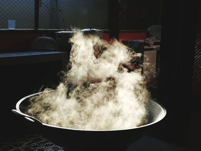 Close-up of smoke coming out from cooking pan at home