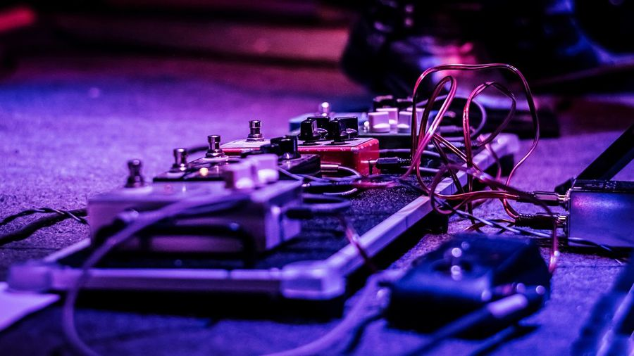 Livestock Recital Music Selective Focus No People Musical Instrument Technology Musical Equipment Metal Close-up Indoors  Still Life Equipment Arts Culture And Entertainment Machinery High Angle View Control Industry Audio Equipment String Instrument Night Purple
