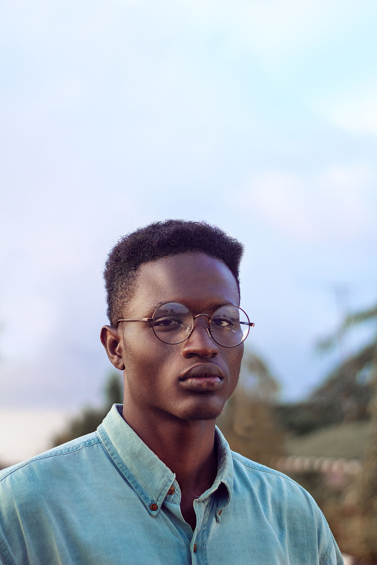 Portrait of young man against sky