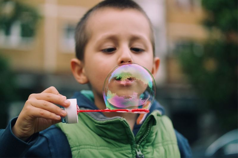 Close-up of boy holding bubble wand