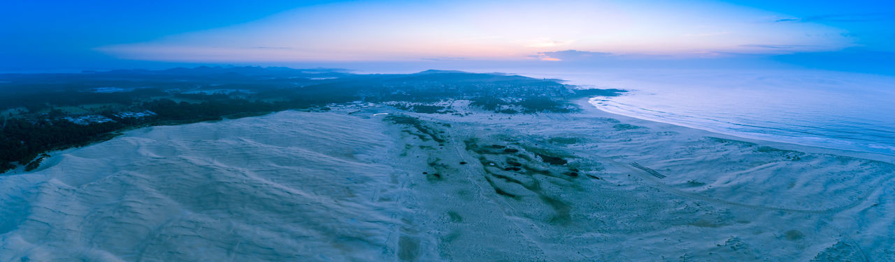 Wide aerial panorama of sand dunes and ocean coastline in the early morning. Anna Bay, New South Wales, Australia Anna Bay Desert High Up Horizon Landscape Panoramic Sky Sun Sunrise Travel Locations Aerial Australia Australian Background Beach Beautiful Birubi Birubi Beach Birubi Point Coast Drone  Dune Environment Golden Holiday Hunter Region Lookout Natural Nature New Nsw Ocean Outdoor Panorama Port Stephens Relax Sand Scenic Sea Seaside South Sunset Tourism Tourist Travel Travel Destinations Vacation View Wales Water