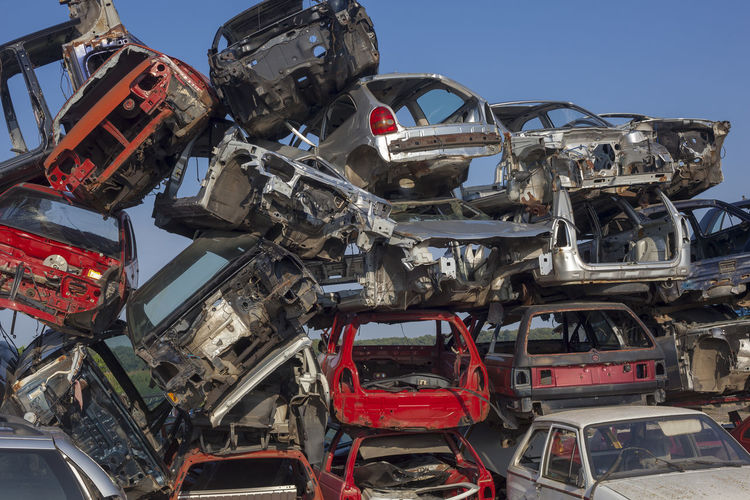 Abandoned Cars In Junkyard Against Clear Sky