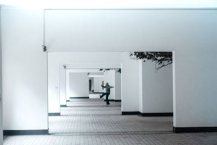 man... Arc+ Tai Chi Architecture Built Structure Arcade Indoors  Entrance Corridor Building Wall - Building Feature Door Full Length Adult Flooring Tiled Floor A New Perspective On Life A New Perspective On Life