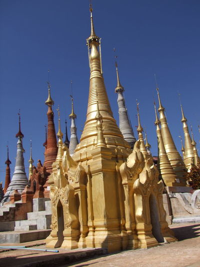 Rebuilt Stupas Blue Sky Buddhism Buddhist Architecture Buddhist Stupas Composition Full Frame Gold Colour Inle Lake Kakku Low Angle View Myanmar No People Outdoor Photography Pilgimage Place Of Prayer Place Of Worship Religion Renovated Stupas Shan State Stupas Sunlight And Shadow Tourism Tourist Attraction  Tourist Destination