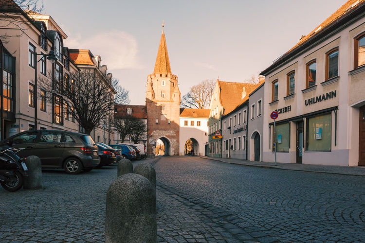 Famous historic city gate of Ingolstadt Residential District Historic Medieval Architecture Built Structure Building Exterior Building City Religion Street Place Of Worship Mode Of Transportation Motor Vehicle Transportation Belief Spirituality Sky Car Land Vehicle Cobblestone Outdoors Spire