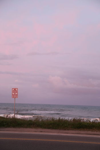 Beach Coastline Florida Horizon Over Water Landscape Nature No People Outdoors Pink Color Road Sign Scenics Sea Sky Sun Rise Text Water