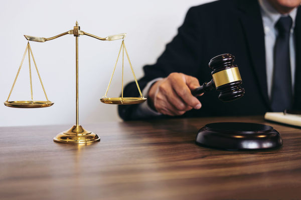 Lawyer Balance Business Business Person Close-up Consultant Courthouse Front View Gavel Holding Human Body Part Indoors  Inheritance Judge Judgement Justice Justice - Concept Law Legal System Legal Trial Men Occupation One Person Scale  Verdict