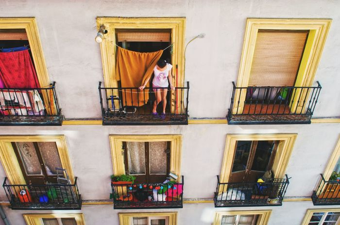 Built Structure Architecture Building Exterior Lifestyles Outdoors One Person People Woman Woman Of EyeEm Madrid Spain Morning Madrid Travel Good Night Good Morning House Houses And Windows Top View Sity Life Woman In Window Day Architecture Enjoy The New Normal Embrace Urban Life Travel Photography