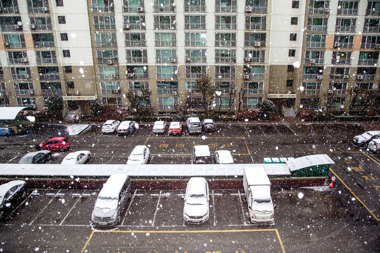 Aerial View Apart Architecture Building Exterior Built Structure City City Life Cityscape Crowded Development Elevated View High Angle View Modern Office Building Parking Lot Residential District Residential Structure Showcase: December Skyscraper Snow Snowing Tall Urban Winter